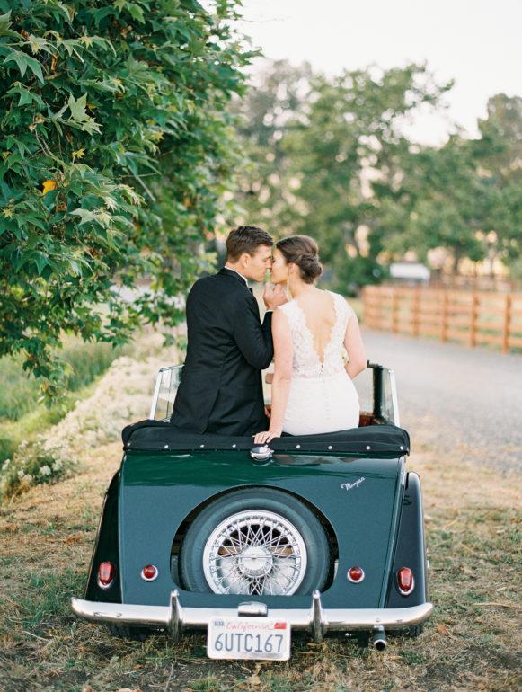 bride and groom in vintage car at la Lomita ranch